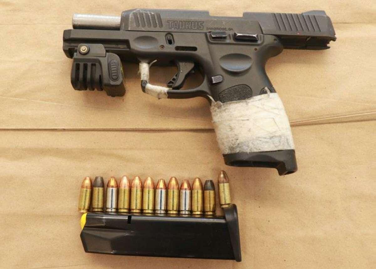 A gun seized during an arrest in Waterbury, Conn., on Thursday, July 22, 2021.
