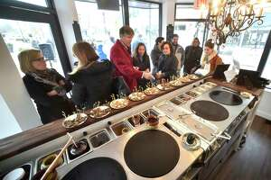 New Haven, Connecticut - Thursday, February 1, 2018: Visitors sample food at Crepes Choupette, a kiosk-like eatery on the Broadway Island at the Broadway Shopping District in New Haven. Plans are before the Darien Planning and Zoning Commission for Crepes Choupette opening a location in downtown Darien.