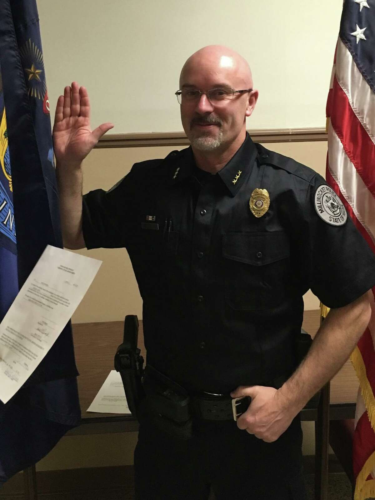 Craig Worster is sworn in as the police chief in Millinocket, Maine.