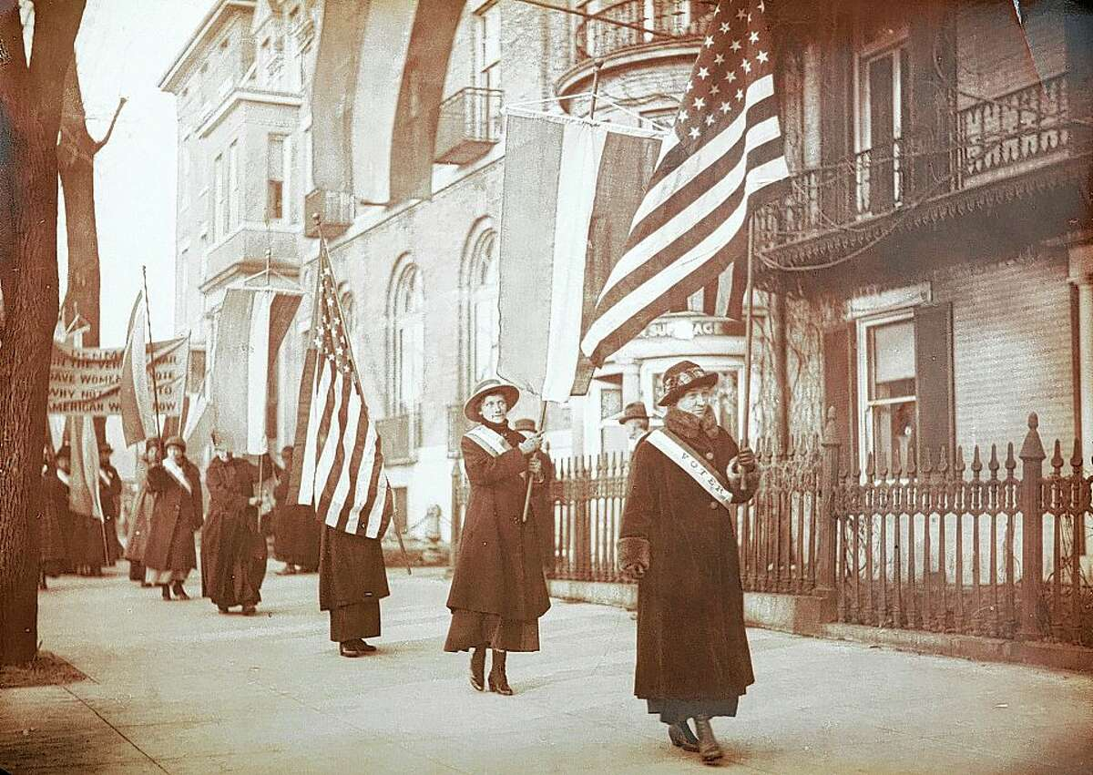 """Women suffragists march in a photograph that is part of """"Voices and Votes: Democracy in America,"""" a traveling exhibit that is part of the Smithsonian Institution's """"Museum on Main Streets"""" program. The exhibit is on display in the Madison County Administration Building atrium and will be at the Jacksonville Area Museum in November."""
