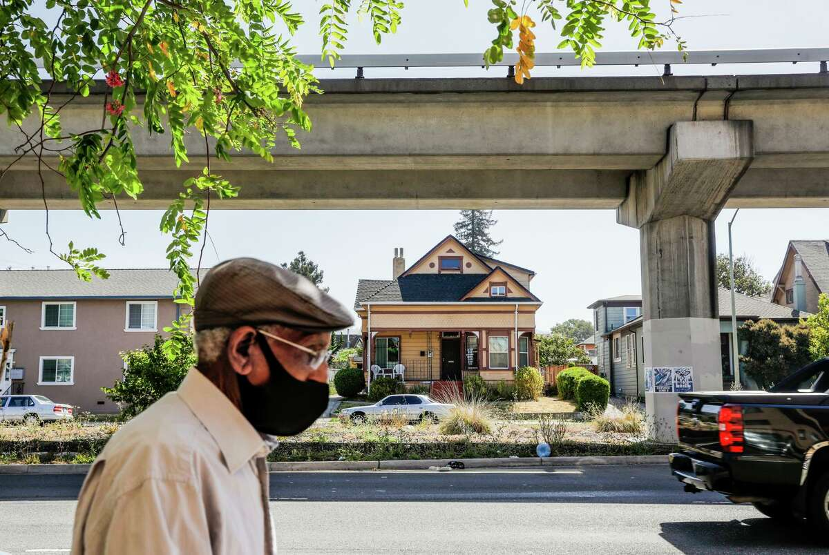 A pedestrian passes Cora Robinson's home in Oakland, which she had appraised last summer.