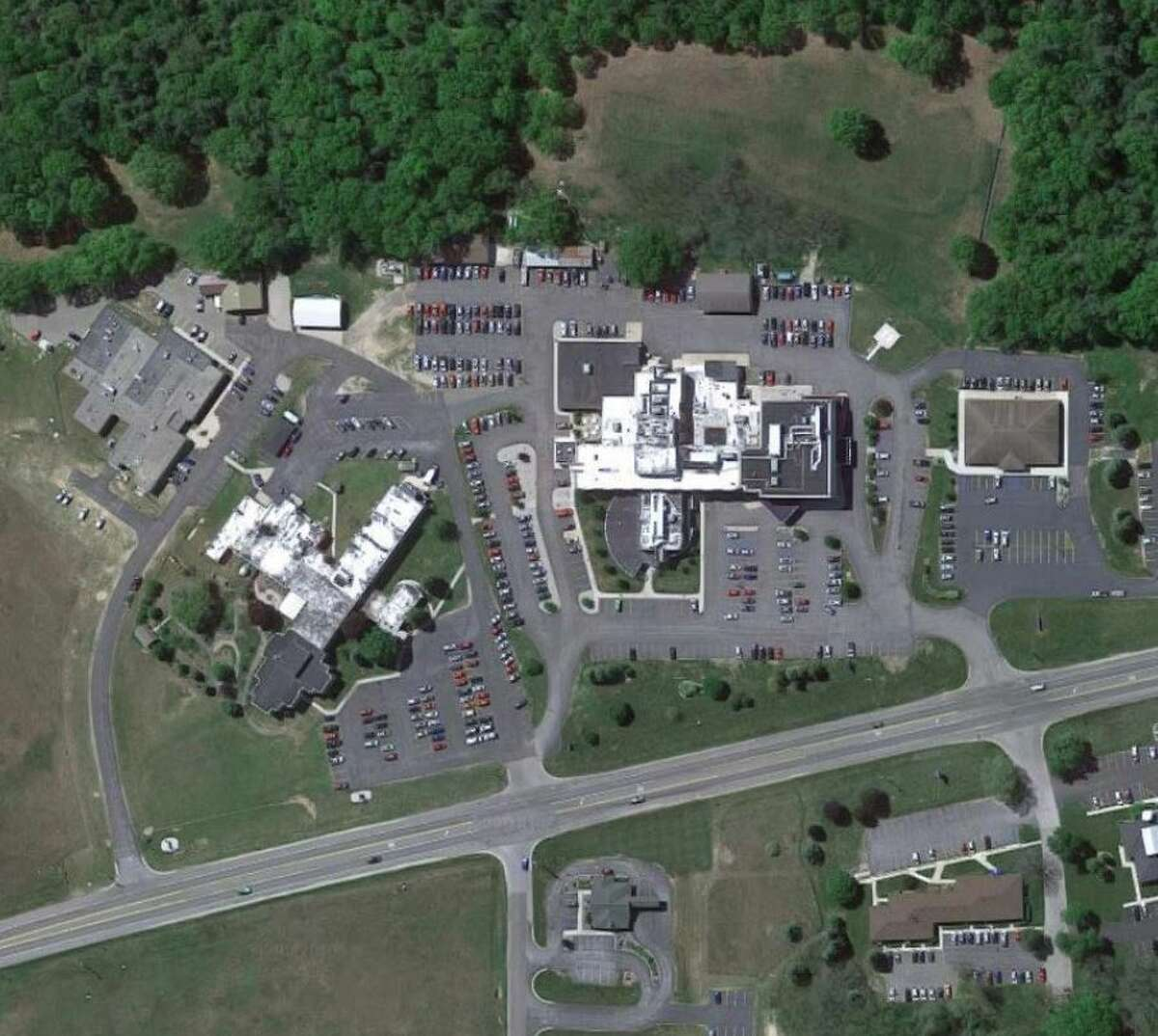 Satellite imagery shows the current outline of the Manistee County Medical Care facility (left) next to Munson Healthcare Manistee Hospital.