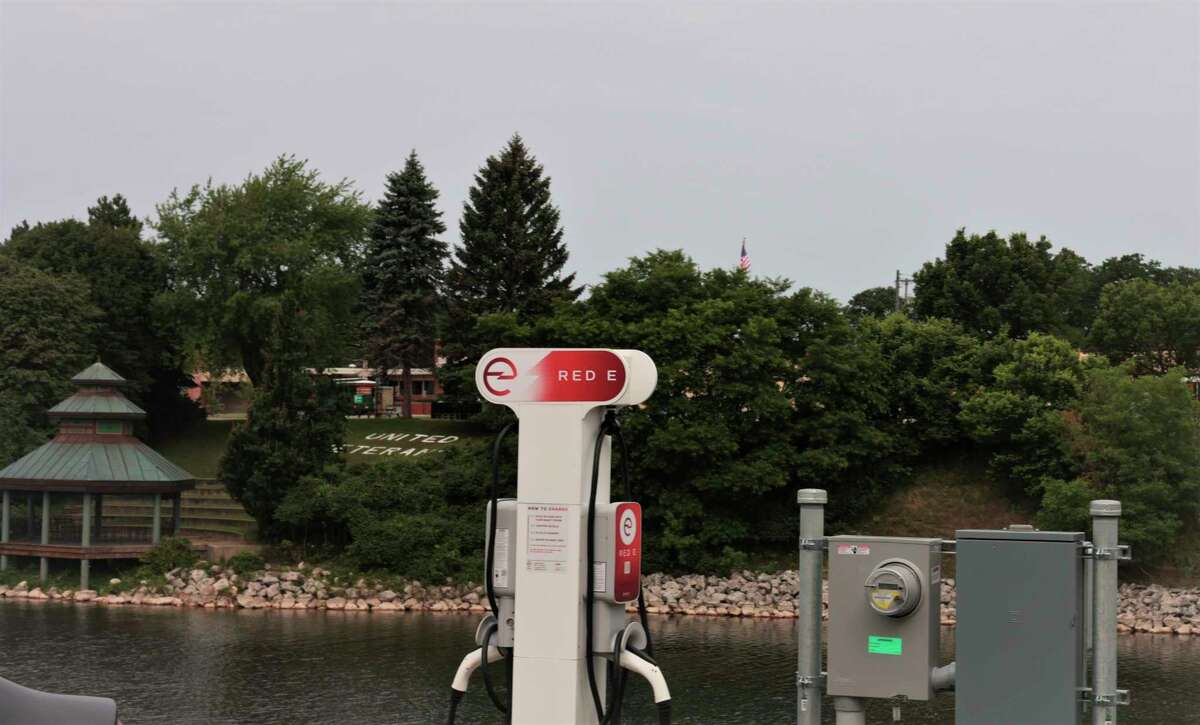 A Red E charging station sits at the parking lot at river street in downtown Manistee over looking the Manistee River. (Jeff Zide/News Advocate)