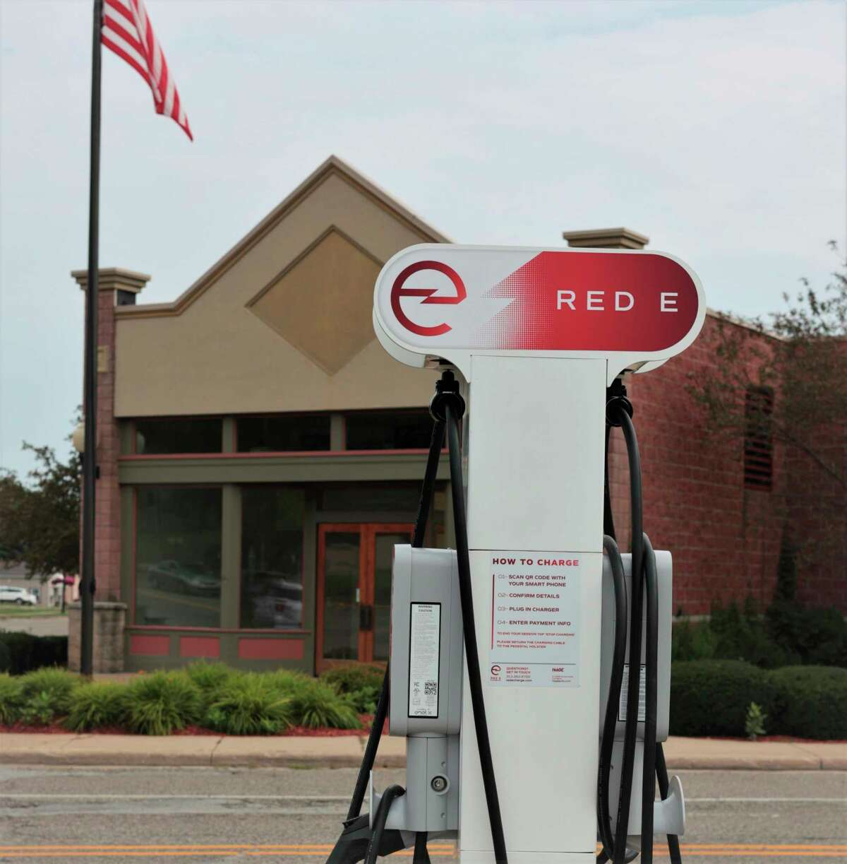 A Red E Charging Station is situated at the parking lot on Washington Street in downtown Manistee across the street from NorthChannelBrewing Company. (Jeff Zide/News Advocate)