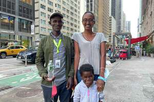 Nagalem Alafa, her father Matios, and their interpreter stand outside in the busy New York City streets a few weeks after her life-saving surgery.