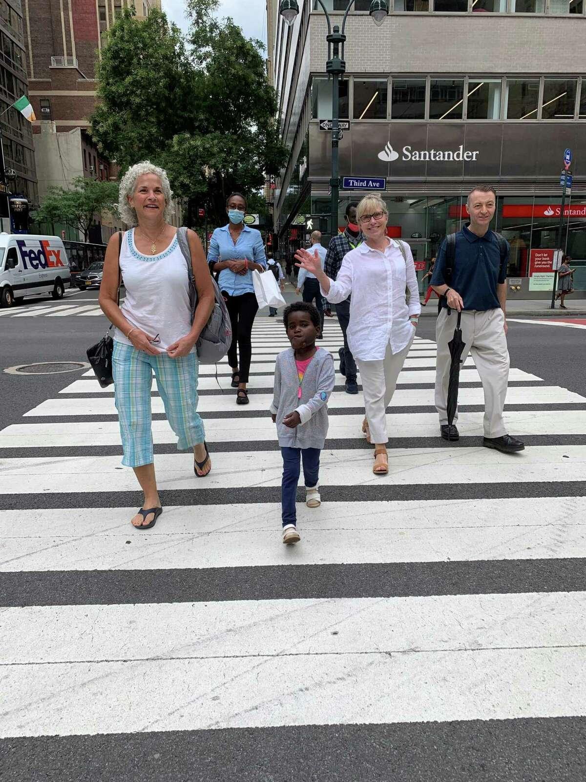 Nagalem leading the way across Third Avenue in New York.(L-R Susan Ketigian, Kalkidan Gebremariam, Nagalem Alafa, Matios Alafa Haile, Casey Saussy, Patrick Brady.)