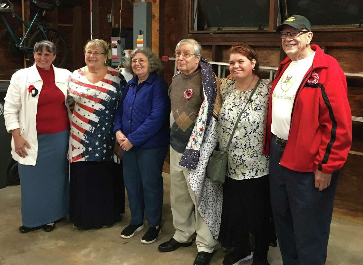 From left, Mystic Chapter No. 20, Order of the Eastern Star Jr Past Grand Matron Jennifer Willich; Worthy Matron Micheline Zumbo; Linda Gersham and Howard Gersham; chapter member Aymee Darko, the Gershams' daughter; and Jr Past Grand Patron William Greene at a ceremony earlier this month at which Howard Gersham, a veteran, was presented with a Quilt of Valor made by chapter members.