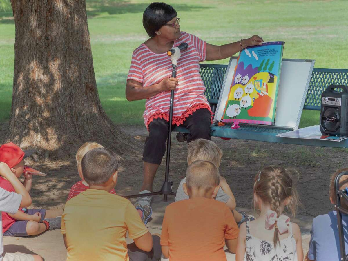 Children, and parents, enjoy a morning of playtime at Grafa Park 07/23/2021 as part of Christ Church Anglican's children's ministries Popsicles in the Park playtime followed by popsicles and story time led by Lois Hillary. Tim Fischer/Reporter-Telegram
