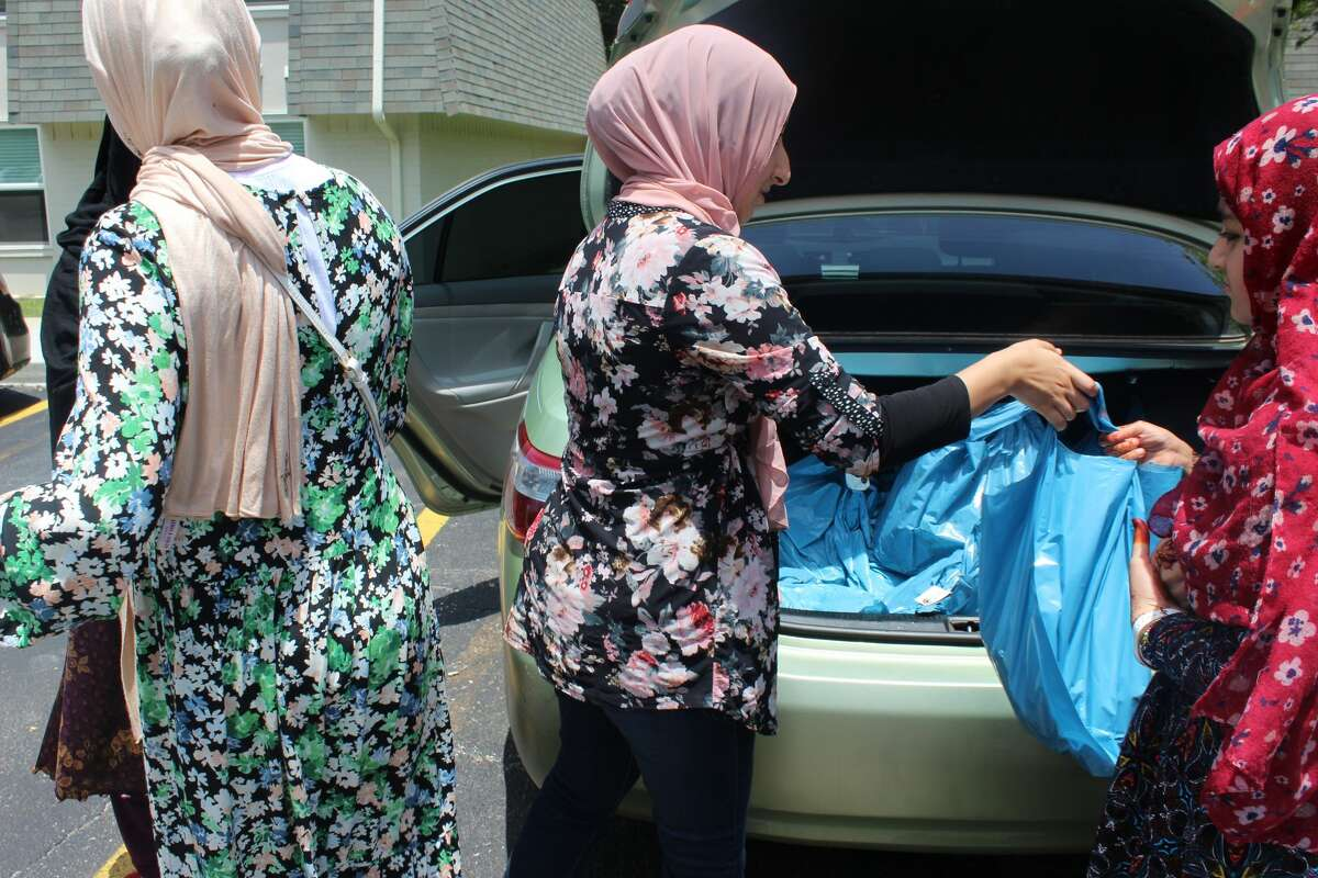 Muslim American Society volunteers distributed meat to about 35 families on Friday.