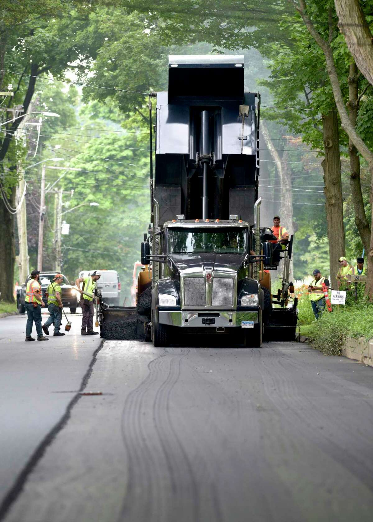 A crew from A&J Construction paves Pleasant Street n Danbury, Conn, on Wednesday morning. July 21, 2021.