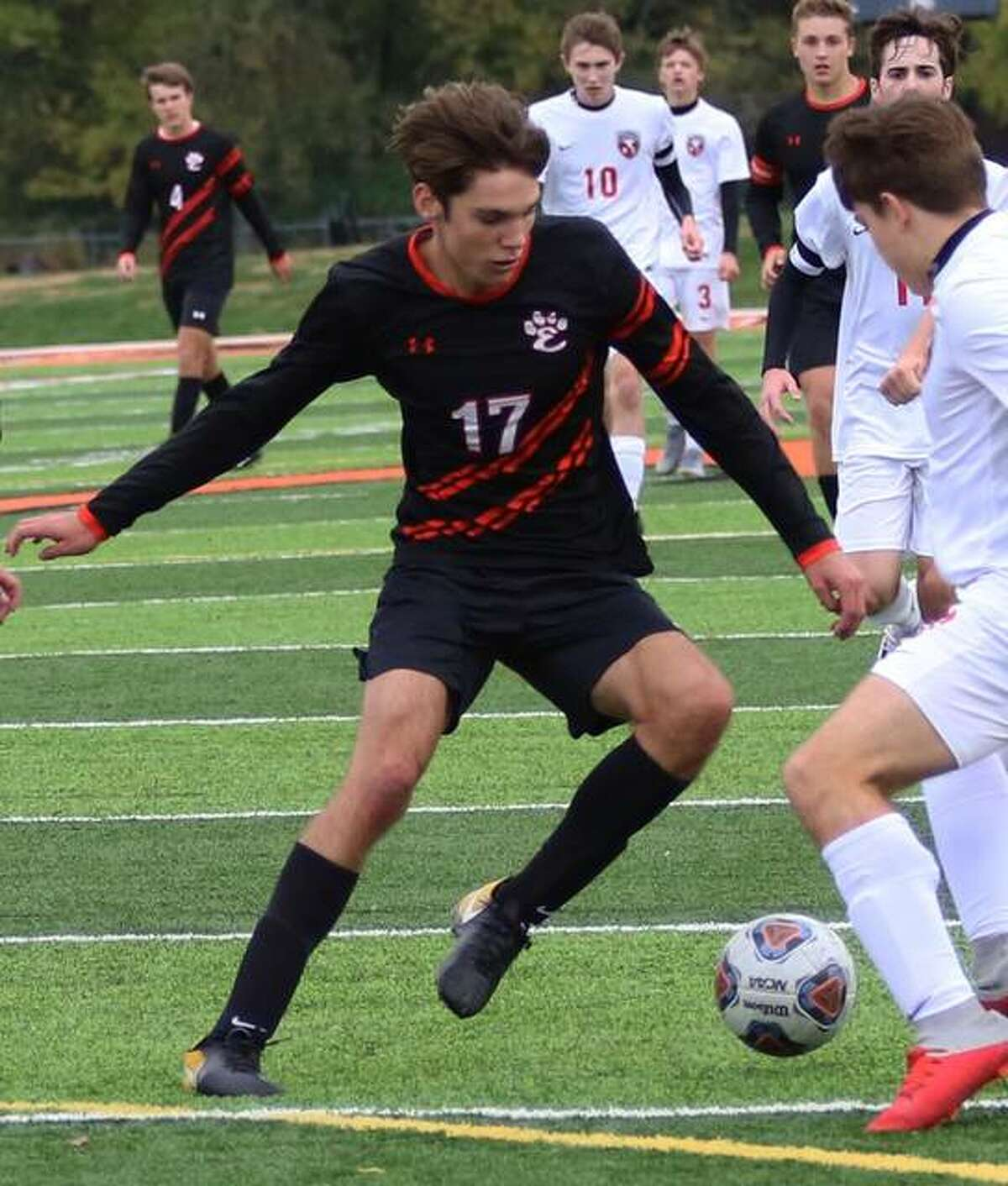 Brennan Weller of Edwardsville battles for the ball during a Southwestern Conference game against Alton.