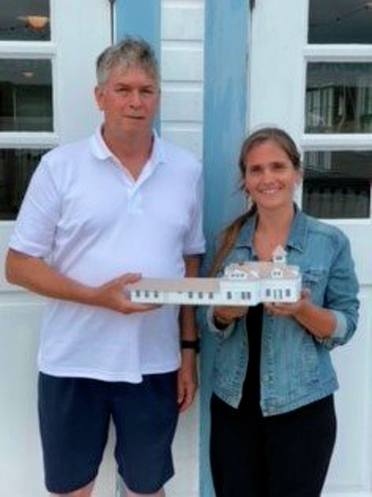 Ralph Moxley and Kristine Mills with Moxley's H-O scale model of the Elberta Lifesaving Station, which was on display for a day during a presentation on Moxley's 330 square foot model of a portion of the Ann Arbor Railroad from Cadillac to Elberta. (Courtesy Photo)