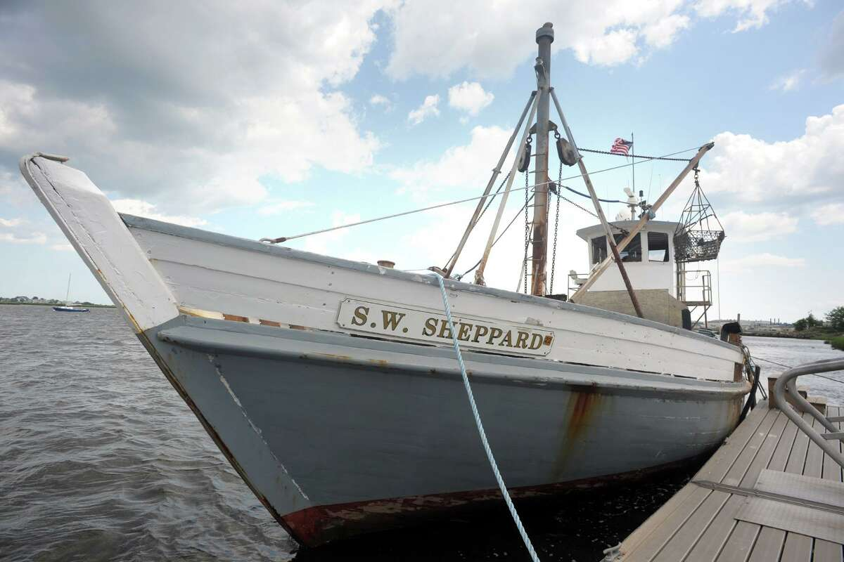 The oyster boat S.W. Sheppard sits at the dock at the Birdseye Street Boat Ramp, in Stratford, Conn. July 23, 2021.