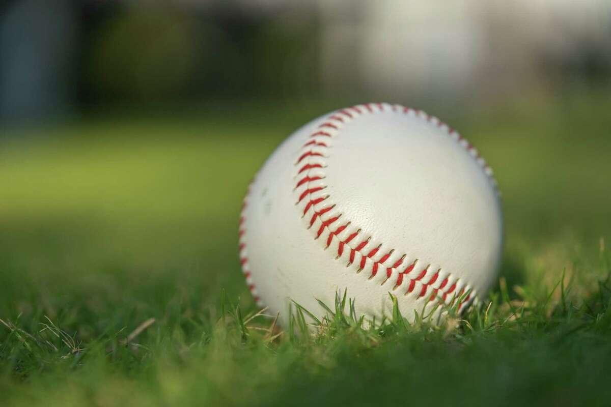 Baseball ball on the green lawn