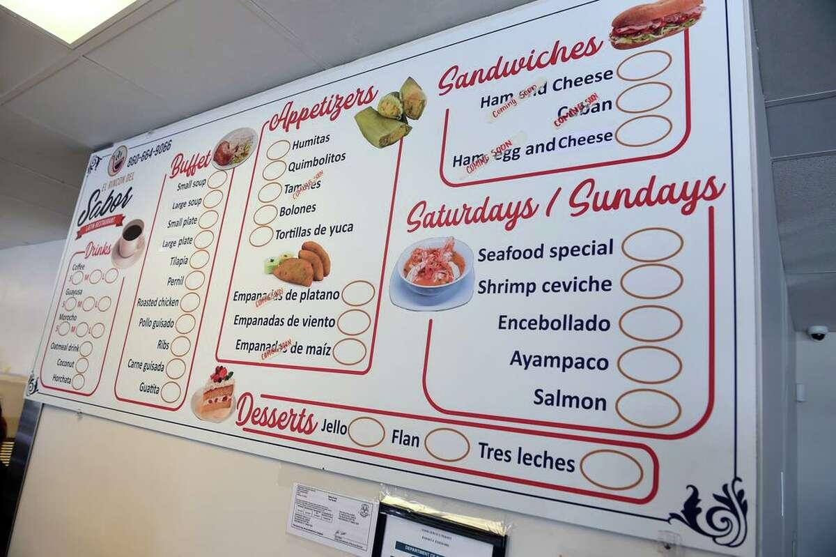 The menu for El Rincon Del Sabor Latin Restaurant displayed in the new Ecuadorian eatery in Westbrook.