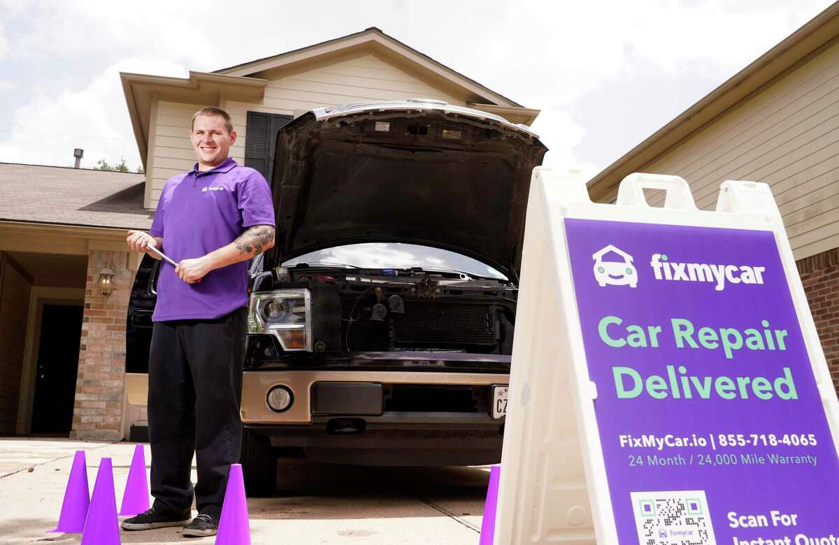 Ford Davis, a FixMyCar mechanic, is shown with his work vehicle Friday, July 23, 2021 in Tomball. FixMyCar sends mobile mechanics to your location for auto repairs.