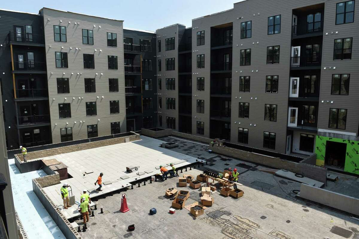 Pavers are installed in the Sports Courtyard of the Olive & Wooster Apartments in New Haven on July 22, 2021.