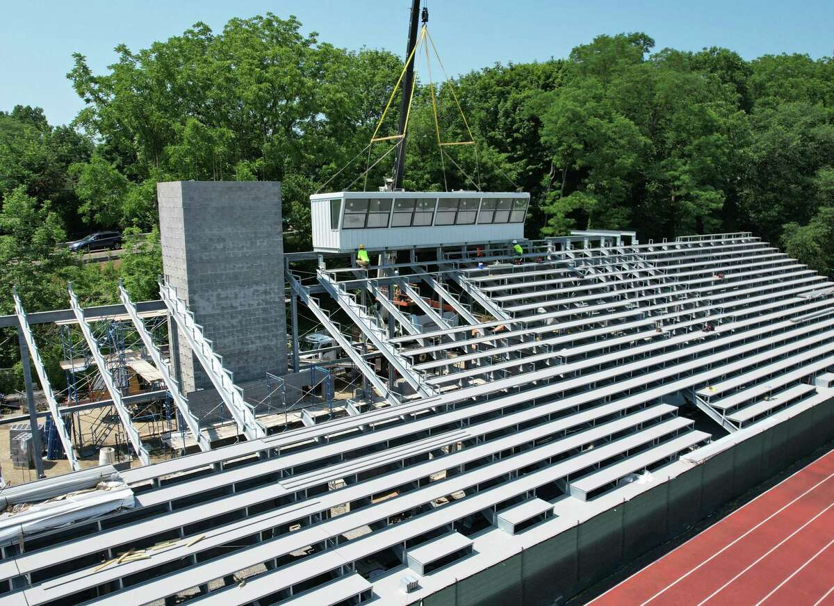 The new press box is lowered on to the Cardinal Stadium bleachers at Greenwich High School in Greenwich, Conn. Tuesday, June 29, 2021. According to the district, the project to renovate the stadium is making good progress and the first phase of the project, which includes the home-side bleachers, could be complete sometime this fall.