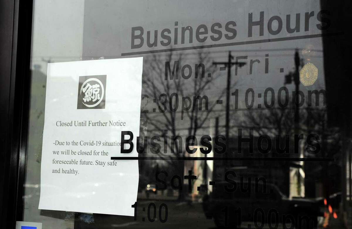 File photo of an eatery notifying customers it is closed until further notice in Fairfield, Conn., 2020.
