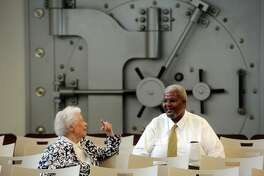 Christine Barber talks with Floyd Batiste, economic development director, at the restored First National Bank on Wednesday. The Port Arthur Economic Development Corporation held a grand opening of the former First National Bank building on Procter Street on Wednesday. The EDC will be located on the first floor as the major tenant. The second floor is open for lease, and the third floor is split between leasable space and the Chamber of Commerce offices. Photo taken Wednesday 3/25/15 Jake Daniels/The Enterprise