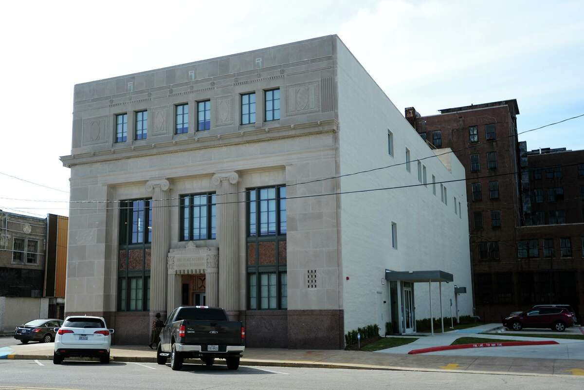Pictured is the facade of the former First National Bank building in Port Arthur. The Port Arthur Economic Development Corporation held a grand opening of the former First National Bank building on Procter Street on Wednesday. The EDC will be located on the first floor as the major tenant. The second floor is open for lease, and the third floor is split between leasable space and the Chamber of Commerce offices. Photo taken Wednesday 3/25/15 Jake Daniels/The Enterprise