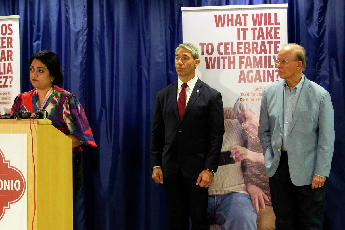 Dr. Anita Kurian, assistant director of Metro Health's Communicable Disease Division, speaks Friday as officials address the uptick in recent COVID-19 cases. Mayor Ron Nirenberg and Bexar County Judge Nelson Wolff stand beside her.