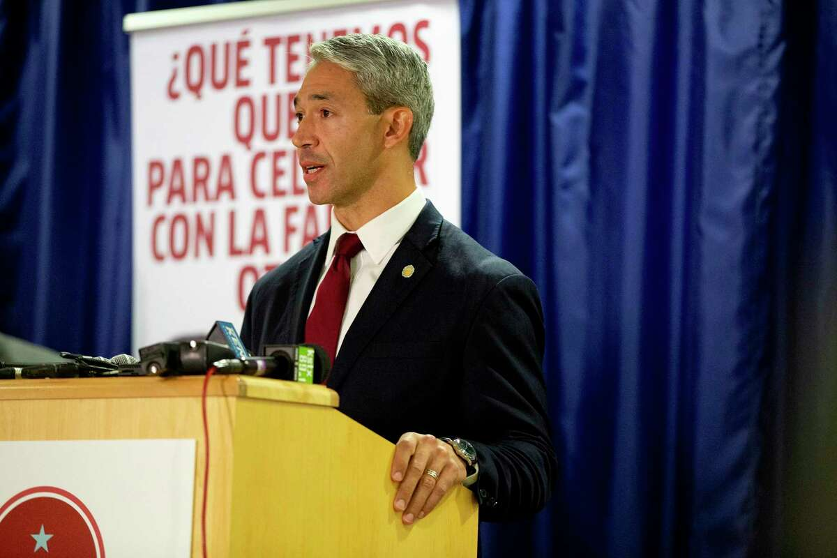 San Antonio Mayor, Ron Nirenberg speaks at a press conference surrounded by city officials about the uptick in recent COVID cases.