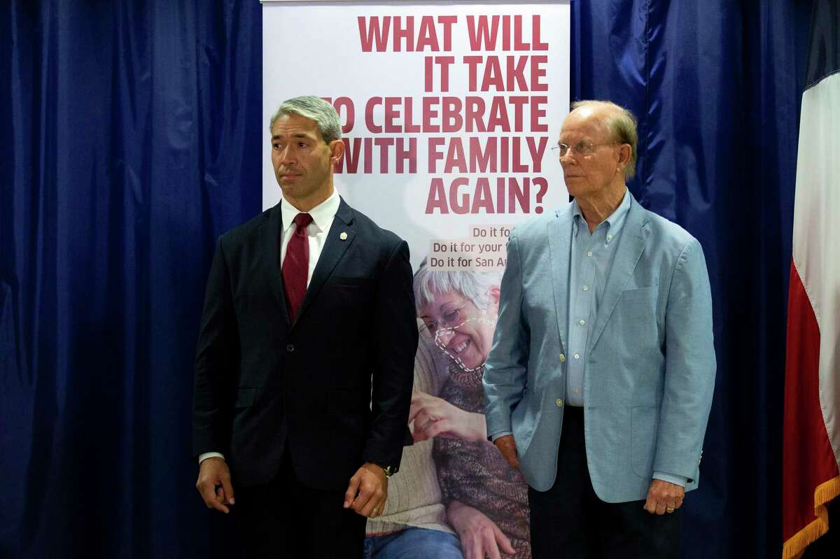 San Antonio Mayor, Ron Nirenberg stands next to Judge Nelson Wolff at a press conference addressing the uptick in recent COVID cases.