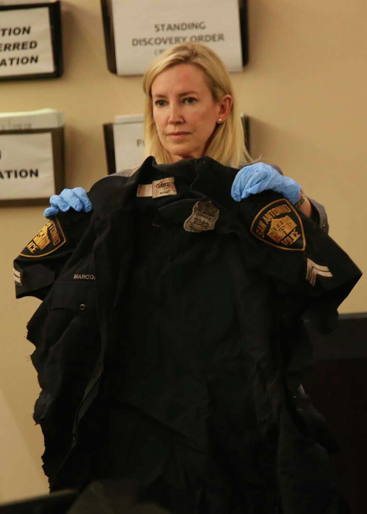 During the capital murder trial of Otis McKane on Friday, July 23, 2021, Bexar County prosecutor Tamara Strauch introduces a uniform worn by Detective Benjamin Marconi on the day he was shot to death.