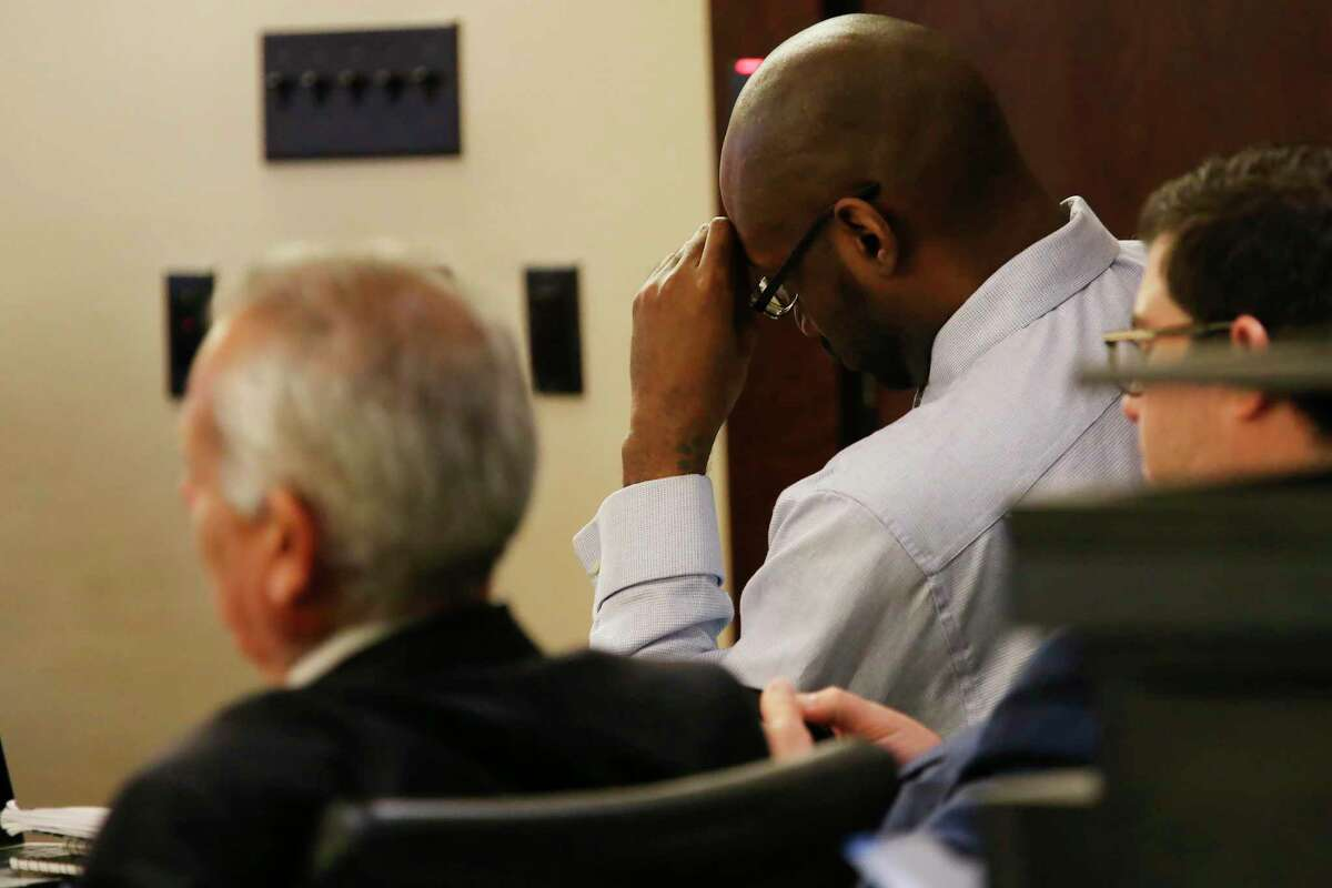 Otis McKane sits with his attorneys as a video of his interrogation is played for the jury Friday, July 23, 2021.