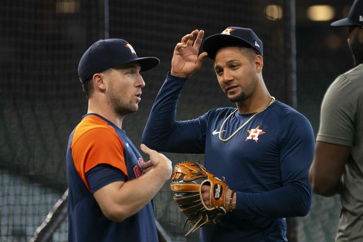 Yuli Gurriel, right, talking with Alex Bregman, will get a day off against the Rangers on Sunday.