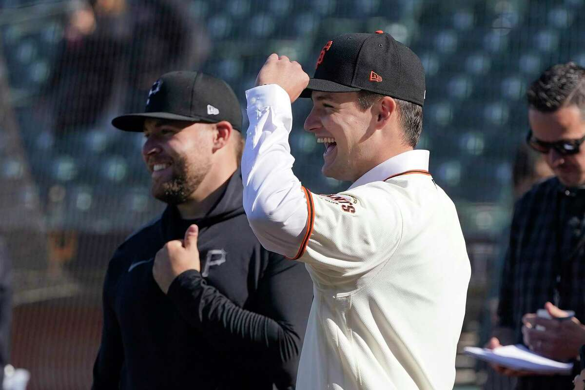 San Francisco Giants draft pick Will Bednar, foreground, smiles as he talks with his brother, Pittsburgh Pirates pitcher David Bednar, left, before a baseball game between the Giants and the Pirates in San Francisco, Friday, July 23, 2021. (AP Photo/Jeff Chiu)