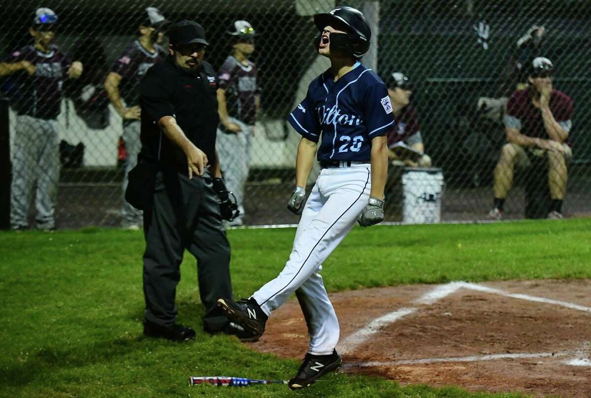 Wilton's Cole Herbst celebrates after crossing the palte in the 4th as Wilton takes on North Haven in the section 1 Little League baseball final Friday, July 23, 2021, at Springdale Field in Stamford, Conn. Wilton advances to state championship series next week.