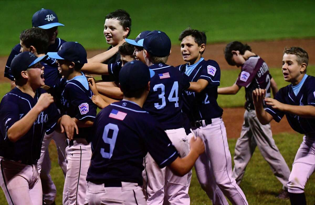 Wilton celebrates after beating North Haven in the section 1 Little League baseball final Friday, July 23, 2021, at Springdale Field in Stamford, Conn. Wilton advances to state championship series next week.