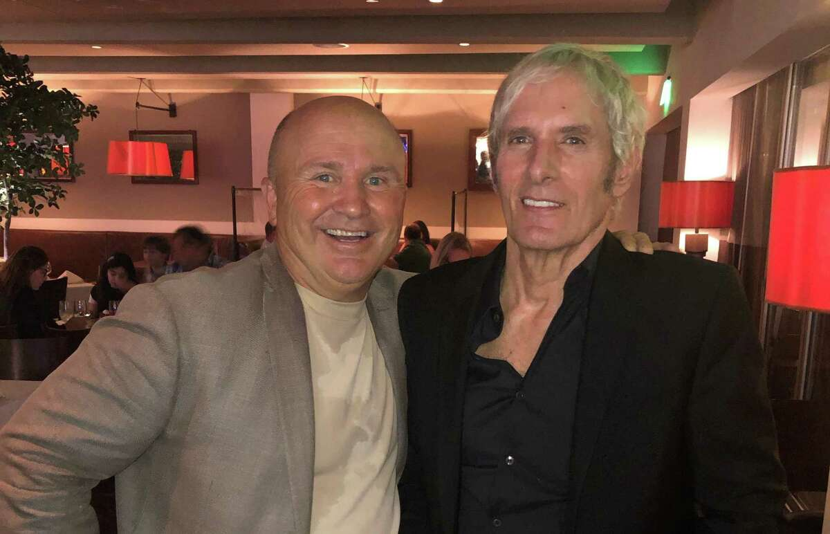 Tony Capasso of Tony's at the JHouse poses for a photo at his restaurant in Riverside with singer/songwriter Michael Bolton, who lives in Westport, on Tuesday, July 20, 2021.