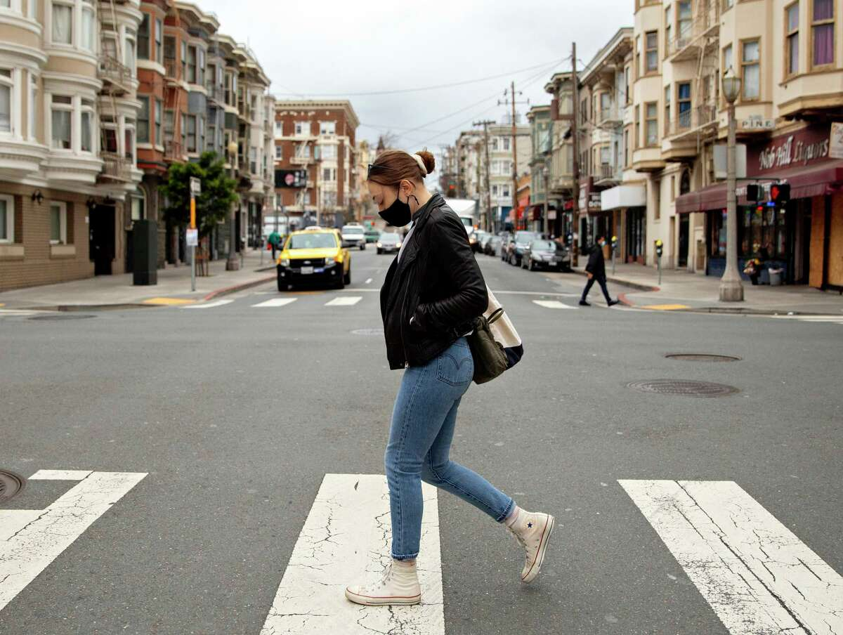 Becca Camping of San Francisco, shown walking along Hyde Street in January, was one of thousands of Californians who whose legitimate unemployment insurance payments were frozen by the state Economic Development Department.