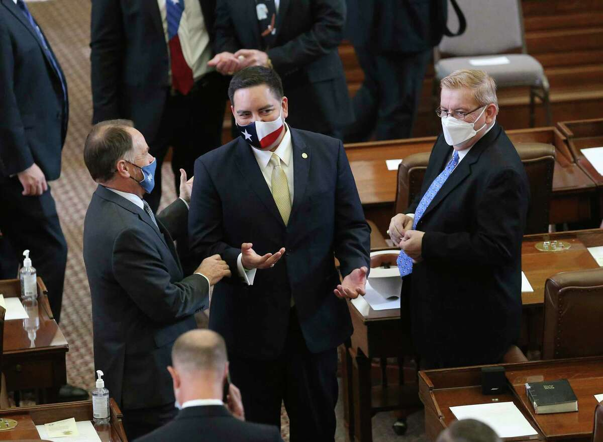 State representative Philip Cortez (center) chats with other state legislators before the convening of the 87th Texas Legislature in Austin on Tuesday, Jan. 12, 2021.