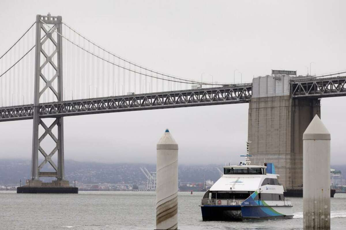 A San Francisco Bay Ferry arrives from Richmond at the ferry terminal. Ferry ridership has slowly increased in recent weeks with more commuters returning to the office and tourists taking public transit.