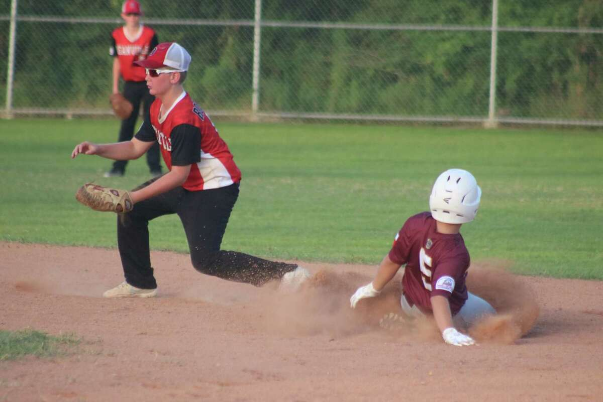 Deer Park's Aiden Gorom slides into second with the stolen base, one of many for Deer Park Friday night. Gorom finished with three RBIs.