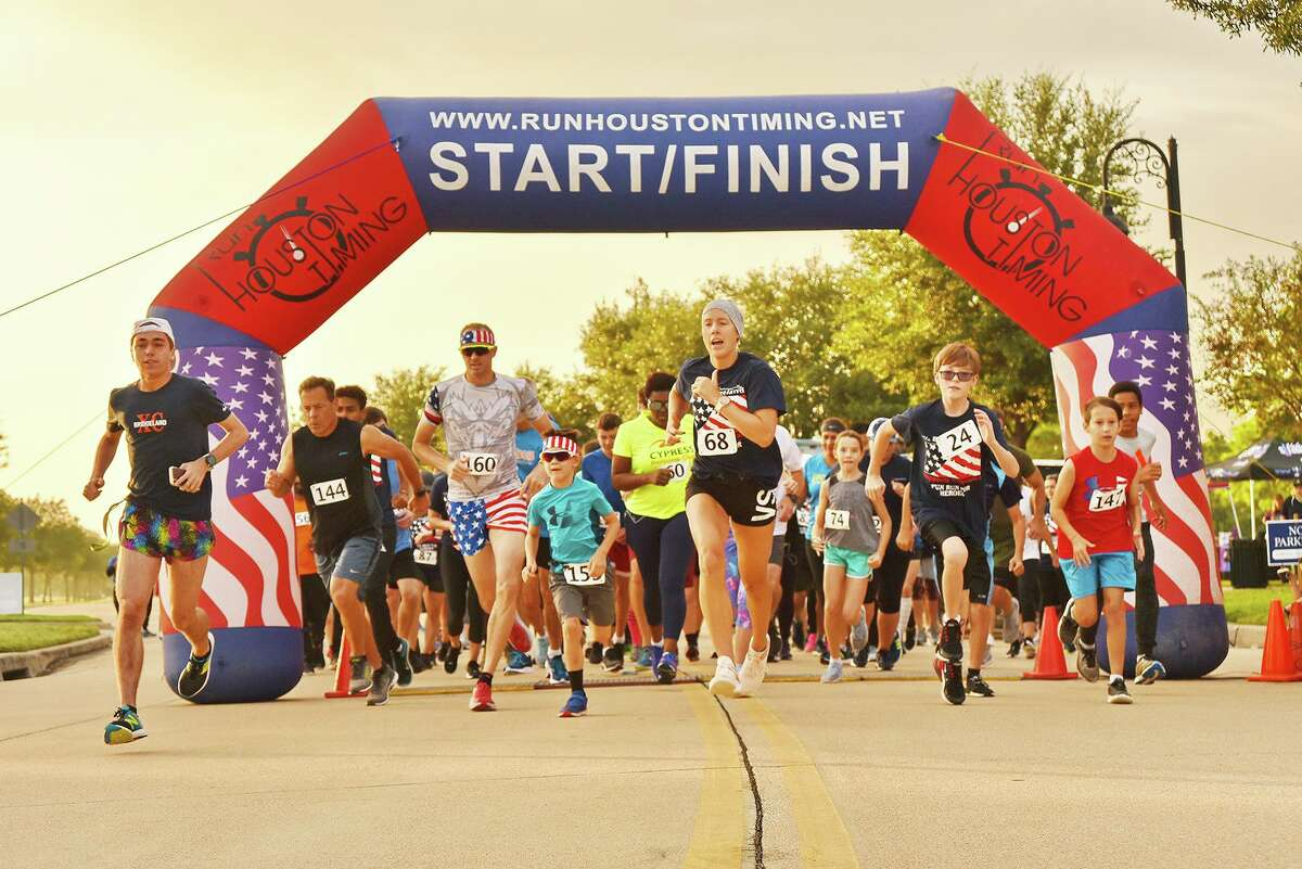 And they're off! Bridgeland residents and friends at the start line for the 2019 Run For Heroes sponsored by the Bridgeland Community Supports Veterans organization. The race helps raise money for veteran events throughout the year.