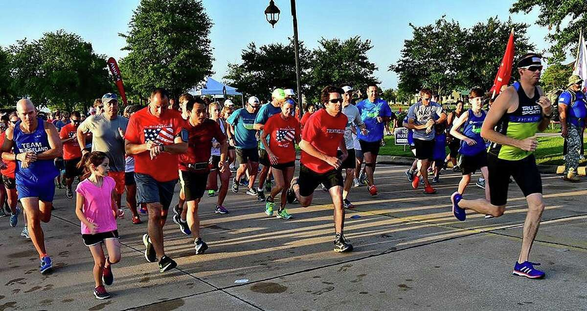 Bridgeland residents in the middle of their race during the 2019 Run For Heroes sponsored by the Bridgeland Community Supports Veterans organization. The race helps raise money for veteran events throughout the year.