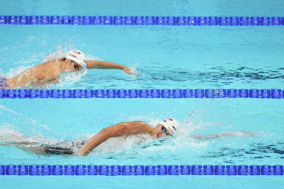 TOKYO, JAPAN - JULY 24: Jake Mitchell (L) of Team United States and Kieran Smith of Team United States competes in heat five of the Men's 400m Freestyle on day one of the Tokyo 2020 Olympic Games at Tokyo Aquatics Centre on July 24, 2021 in Tokyo, Japan. (Photo by Tom Pennington/Getty Images)