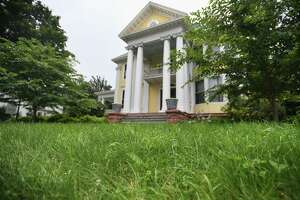 The Colorblends House property at 893 Clinton Avenue, known for being covered in thousands of colorful tulips each spring, was forced to trim back meadow-like grasses to avoid a fine for blight in Bridgeport Conn. on Wednesday, July 21, 2021