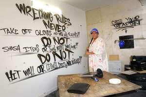 Co-owner Mercedes Miller poses in the wrecking room at Aunt Spazz, in Bridgeport, Conn. July 22, 2021.