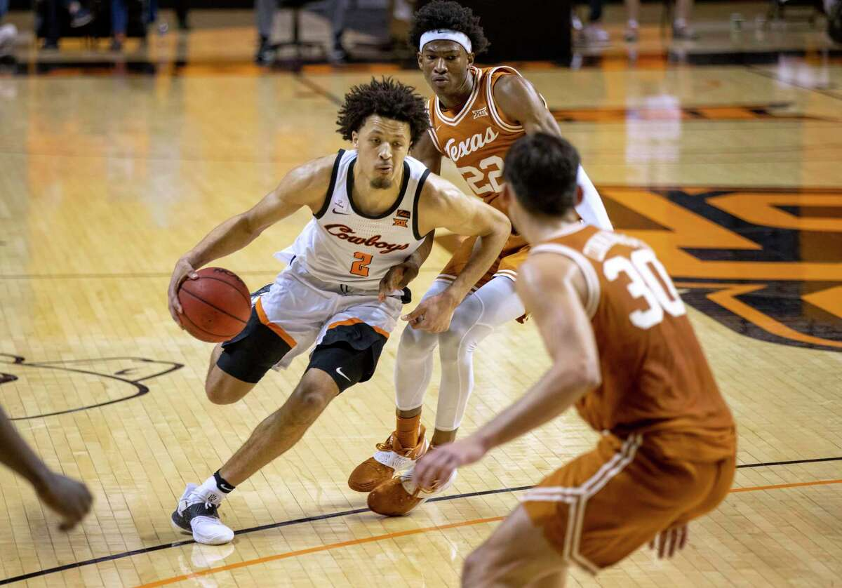 Oklahoma State guard Cade Cunningham, driving against Texas, is a 6-foot-8 ballhandler with the ability to play on or off the ball. He's widely expected to be the No. 1 NBA draft pick after one year with the Cowboys.