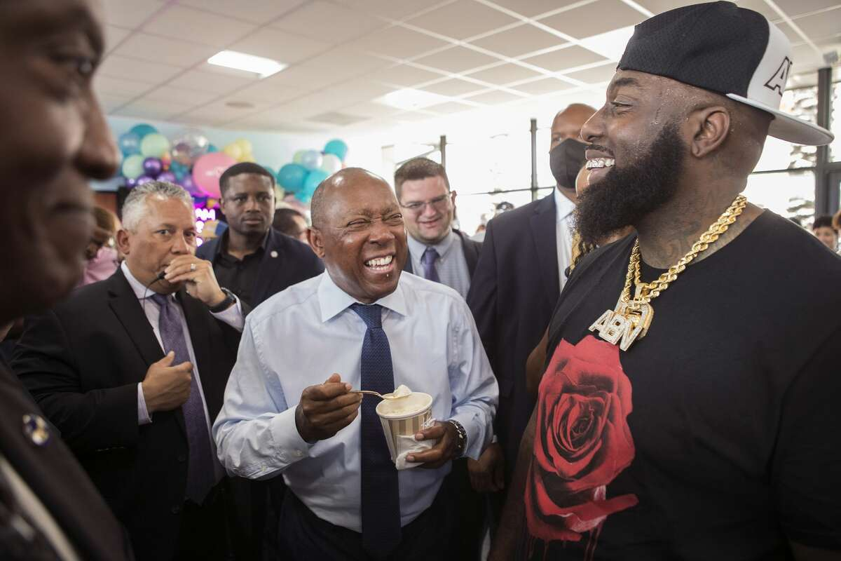 Mayor Sylvester Turner enjoys some ice cream with rap artist Trae the Truth during the grand opening of Howdy Homemade Ice Cream Thursday, July 22, 2021 in Katy. Hundreds of people flocked to the new ice cream franchise, owned and run by Houston rap artist, activist and philanthropist Trae tha Truth and his business partner Roderick Batson. The shop's mission is not just to serve up hand scooped ice cream but to also give employment opportunities to adults with special needs.