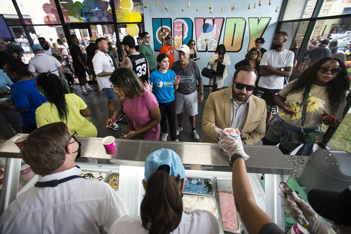 Customers line up for ice cream during the grand opening of Howdy Homemade Ice Cream Thursday, July 22, 2021 in Katy. Hundreds of people flocked to the new ice cream franchise, owned and run by Houston rap artist, activist and philanthropist Trae tha Truth and his business partner Roderick Batson. The shop's mission is not just to serve up hand scooped ice cream but to also give employment opportunities to adults with special needs.