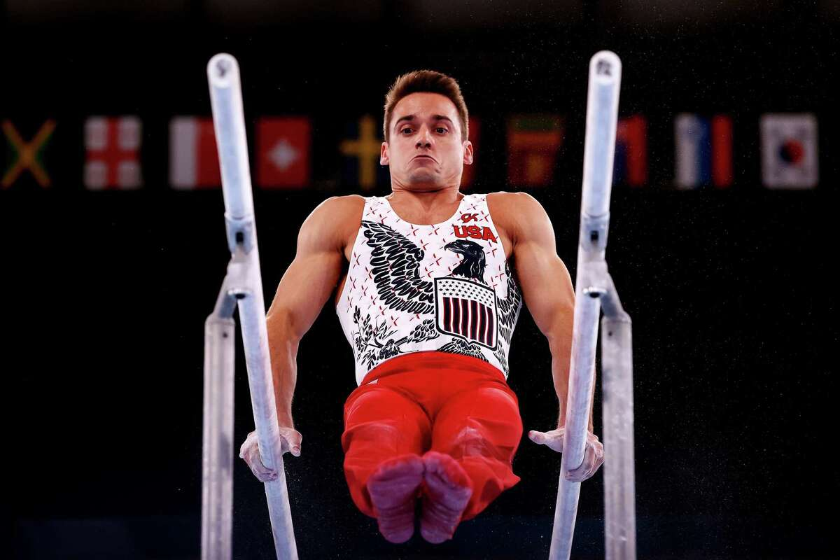 TOKYO, JAPAN - JULY 24: Samuel Mikulak of Team United States competes on parallel bars during Men's Qualification on day one of the Tokyo 2020 Olympic Games at Ariake Gymnastics Centre on July 24, 2021 in Tokyo, Japan.