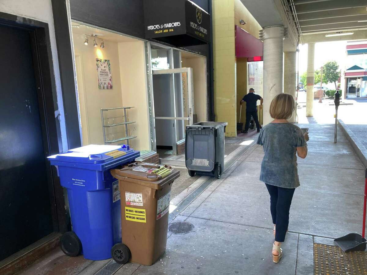 The aftermath of a shooting in downtown San Rafael that left two people dead and four injured was still visible the morning after, with broken glass and bullet holes in storefronts.