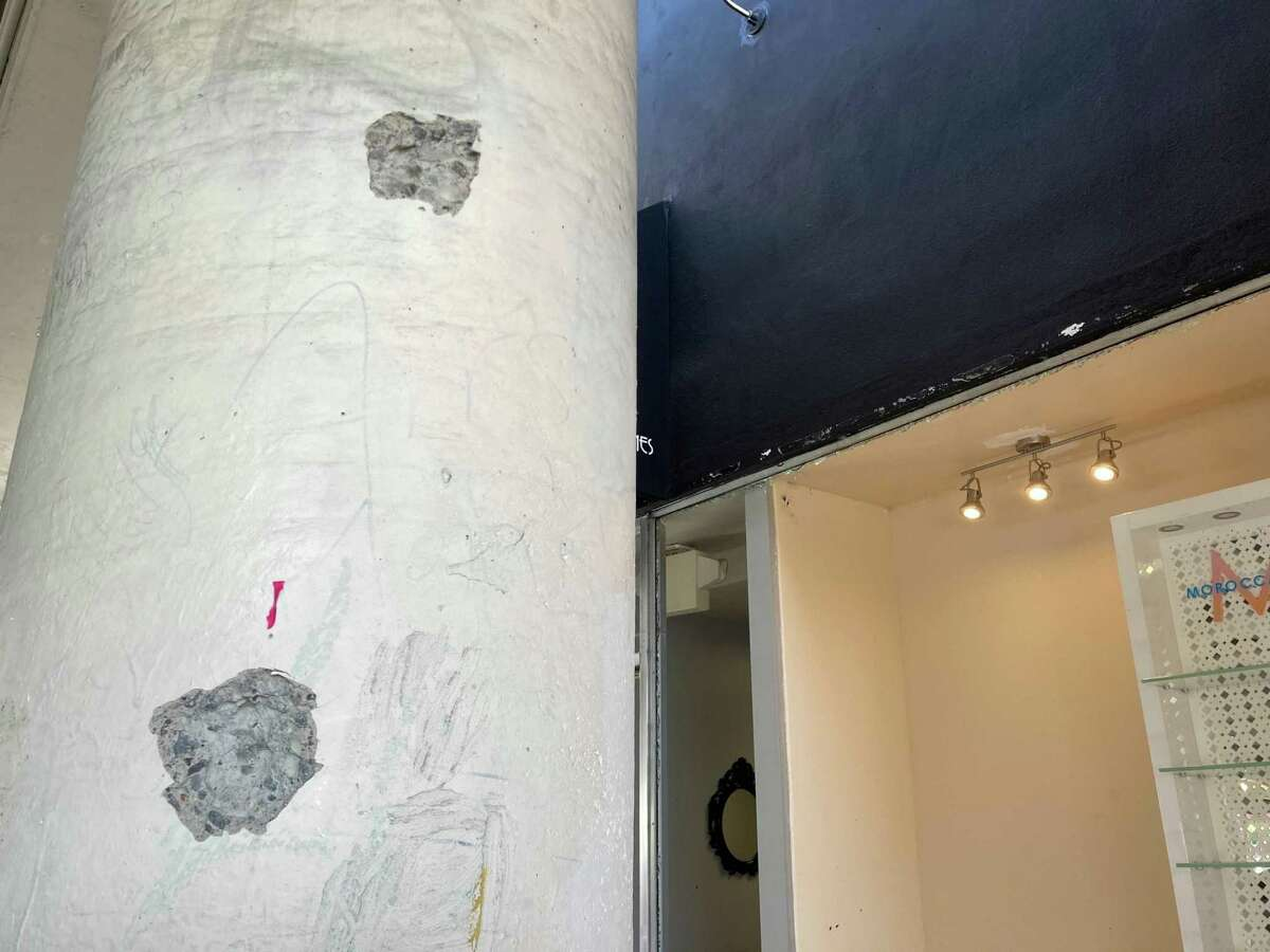 Bullets tore chunks of concrete out of a pillar beneath a parking garage in downtown San Rafael during deadly gunfire.